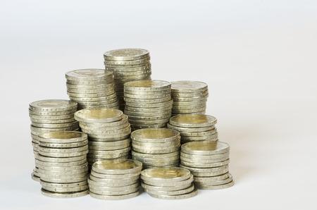 eur: several piles of money on white background Stock Photo