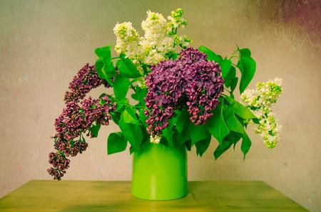 spring lilac in green vase photo