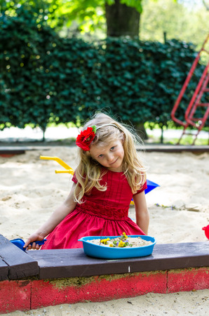sandpit: beautiful blond girl playing in sandpit