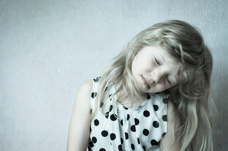 desaturated: beautiful child girl with long blond hair desaturated effect