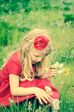 alergy: beautiful blond girl with dandelion