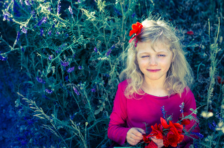 corn flower: beautiful blond girl with red corn poppy flower