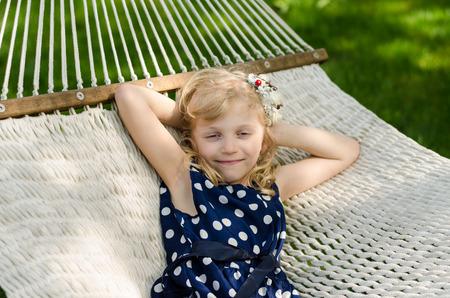 blond girl: beautiful blond girl lying in hammock Stock Photo