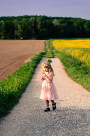 blond girl: blond girl walking in path between fields