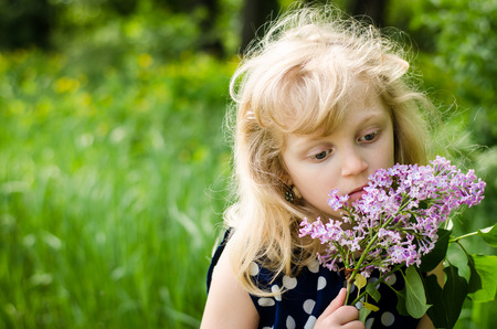 cute girl with long hair: portrait of beautiful sad blond girl holding flower