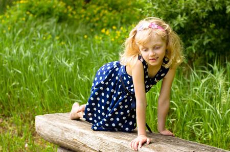 mischievous: beautiful mischievous blond girl in bench