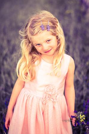 blond girl: blond girl in pink dress retro effect