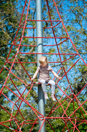 aspirational: girl climbing up on a playground