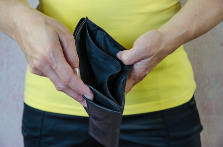 economic issues: female hands showing empty wallet