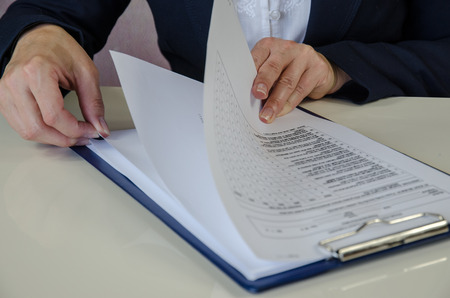 female hand checking documents