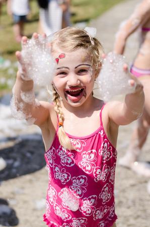 foam party: happy girl enjoying foam party