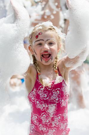 foam party: smiling blond girl enjoying foam party Stock Photo