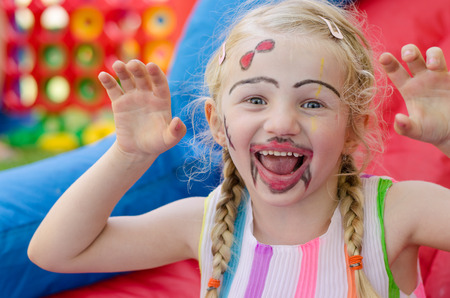 beautiful blond girl with colorful facepainting