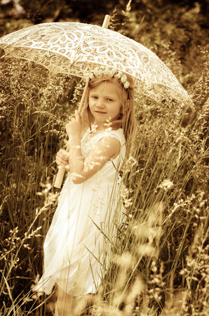 sunshade: girl with long hair holding sunshade umbrella  retro filtered effect