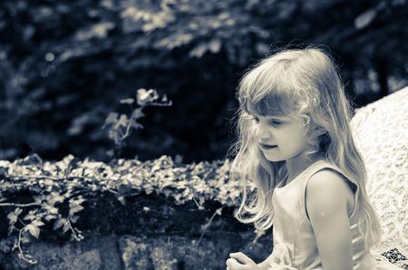 vintage leaf: little blond girl with long hair portrait filtered effect