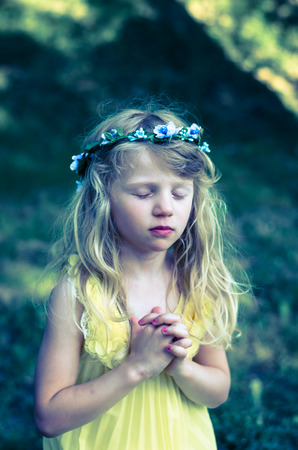 vow: adorable little girl praying vow Stock Photo