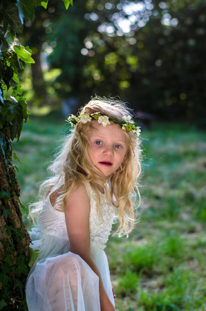 blond girl: adorable blond girl in nature Stock Photo