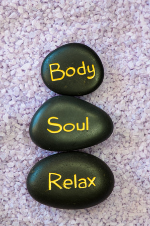 body and soul: black lava stone with words body, soul, relax