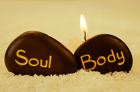 white sea salt and black lava stone with words body and soul