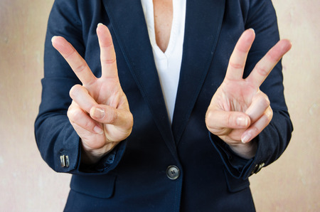 business symbol: business concept with victory gesture