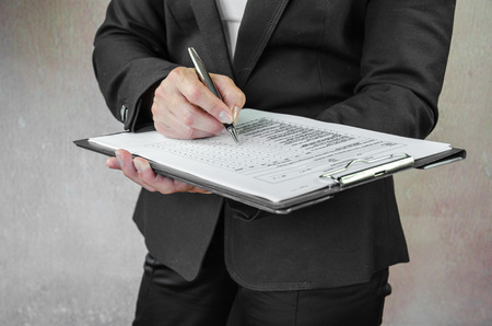 fill fill in: business concept with pen and questionnaire
