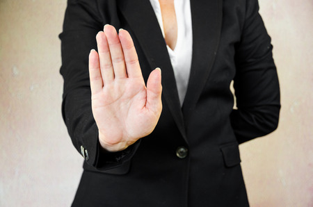 hand stop: business concept with stop gesture symbol