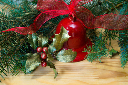 jingle bell: Christmas decoration with red jingle bell, holly and green needle branch