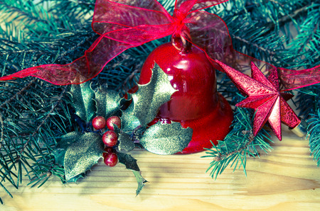 jingle: Christmas decoration with red jingle bell, holly and green needle branch