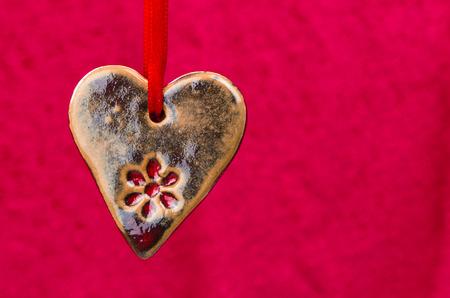 hanged: hanged brown ceramics heart purple background