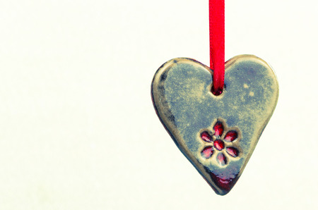 hanged: hanged brown ceramics heart isolated