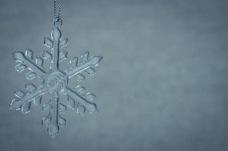crystal background: crystal snowflake decoration against blue background