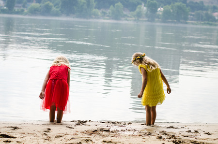 nymphs: beautiful blond girls nymphs dancing by the river strand rear view