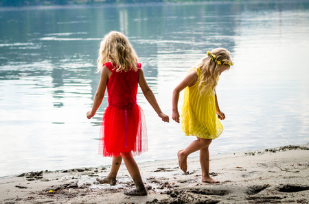 beautiful blond girls nymphs dancing by the river strand rear view