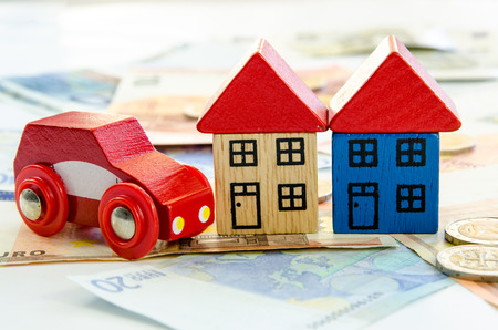 toy house: wooden toy house, car and banknotes Stock Photo