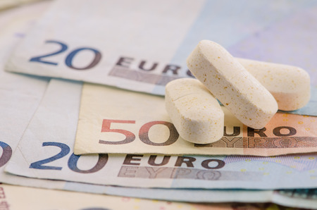 denomination: euro banknotes with different denomination and pills