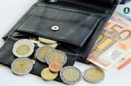 coin purses: banknotes and coins in black purse