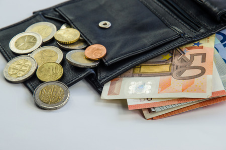 change purses: banknotes and coins in black wallet