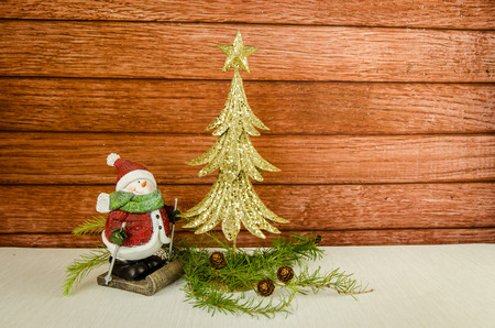 limb: golden christmas tree, snowman and coniferous tree limb Stock Photo