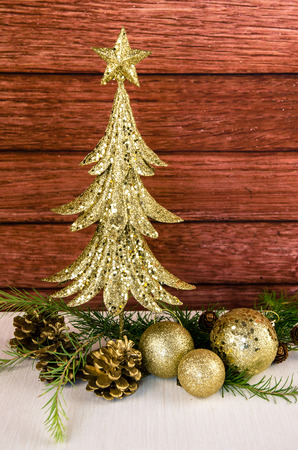 limb: golden christmas tree, baubles and coniferous tree limb Stock Photo