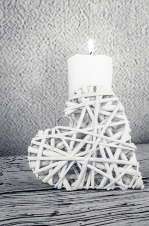 bougie coeur: white burning candle and white heart decoration
