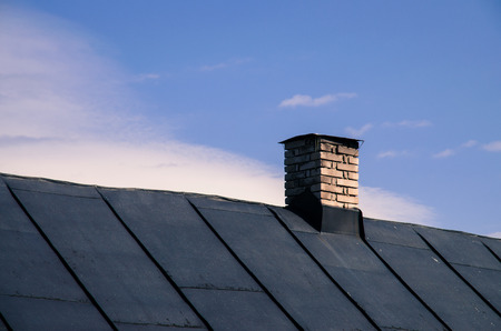 brick chimney on the roof of house 스톡 콘텐츠