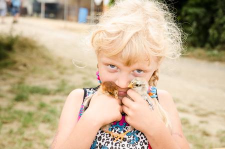blond girl: adorable caucasian blond girl holding little ducks