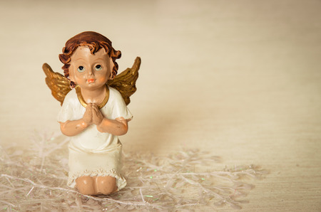 innocent: innocent praying angel with playing gesture