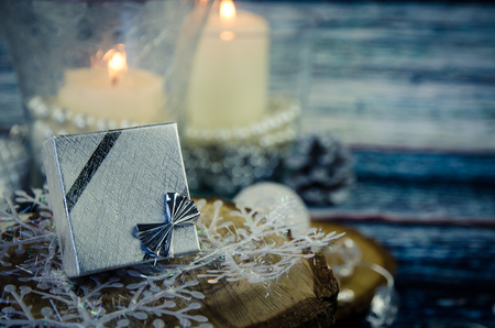 candle: silver present box and burning candles decoration Stock Photo
