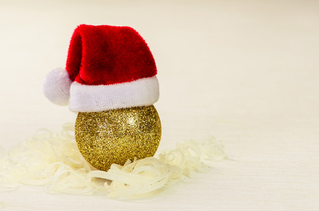 golden ball: golden Christmas bauble with red Santa Stock Photo