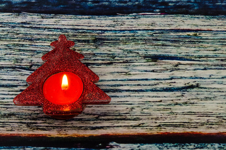 candleholder: burning candle in candleholder with shape of tree Stock Photo