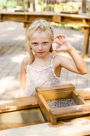 nugget: adorable little blond girl with nugget gemstone