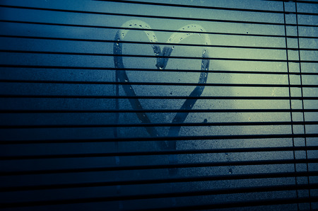 steamy: heart drawn on steamy window