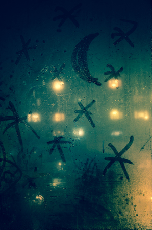 steamy: moon and stars drawn on steamy window Stock Photo