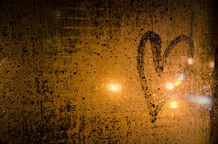 heart drawn on steamy window